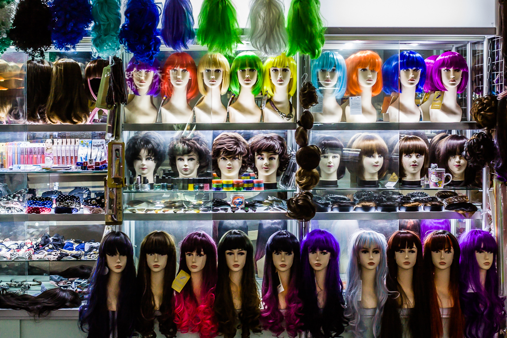 SalonSabina Wigs Hung Up On Wall Bristol Make Up Artist and Hair Stylist
